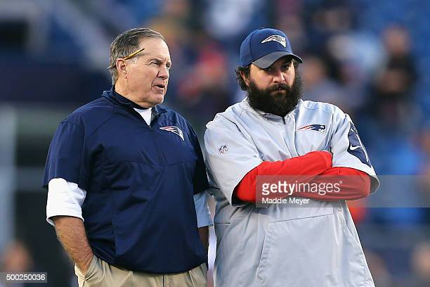 Patriots head coach Bill Belichick of the New England Patriots talks with defensive coordinator Matt Patricia before their game against the...