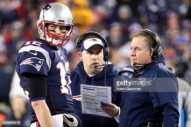 Patriots Head Coach Bill Belichick offensive Coordinator Josh McDaniels and Tom Brady of the New England look on during a time out in the first half...