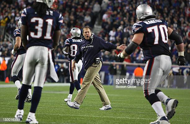 Patriots head coach Bill Belichick runs onto the field and yells and motions for his players to get off the field following a second quarter scrum...