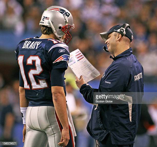 Patriots offensive coordinator Bill O'Brien makes a face as he talks to quarterback Tom Brady in the fourth quarter The New England Patriots meet the...