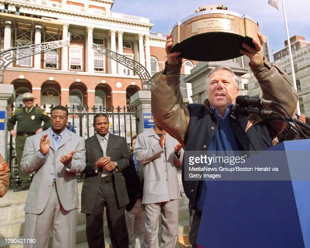 Patriots owner Bob Kraft holds up the trophy the Patriots got after winning the Championship game against the Stealers at a rally at the State House....
