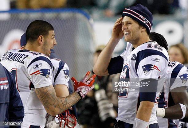 Patriots players Aaron Hernandez and Tom Brady talk on the sidelines during the game The New England Patriots play the Philadelphia Eagles at Lincoln...