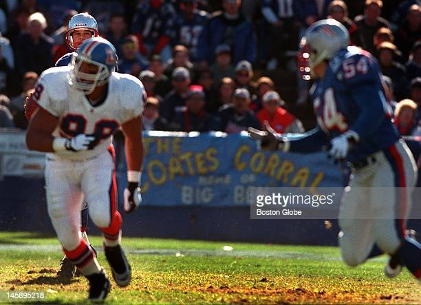 Patriots punter Tom Tupa eyes Tedy Bruschi downfield as Broncos Maa Tanuvasa looks for a receiver on the ill fated fake punt in the first quarter