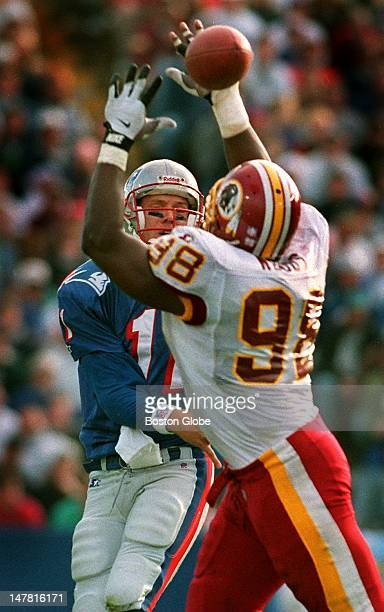 Patriots QB Drew Bledsoe gets off a pass through the outstretched arms of Washington DE Tony Woods