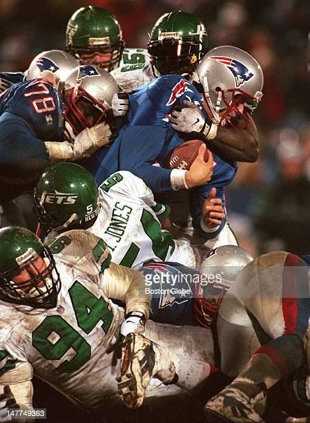 Patriots QB Drew Bledsoe plows his way forward for a first down on a keeper