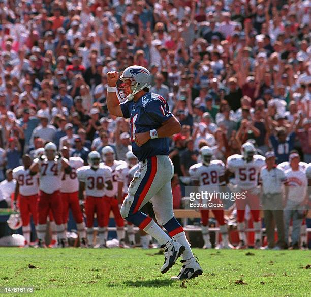Patriots QB Drew Bledsoe pumps his fist as he heads for the bench following a New England TD during their 310 victory over Arizona