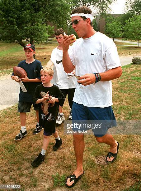 Patriots QB Drew Bledsoe thought he could sneak into the Bryant College Cafeteria for an apple before a running drill but found a gaggle of young...