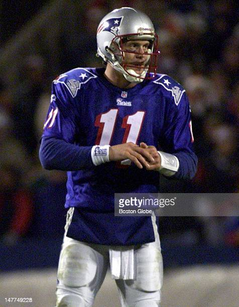 Patriots quarterback Drew Bledsoe favors the index finger on his right hand during the fourth quarter game winning touchdown drive vs the Dolphins...