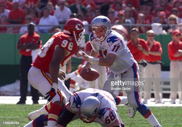 Patriots quarterback Drew Bledsoe has Chiefs Eric Hicks in is face as his line lets down.