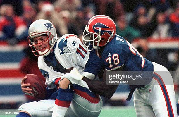 Patriots quarterback Drew Bledsoe is sacked by Bills Bruce Smith The Bills won the game 1310