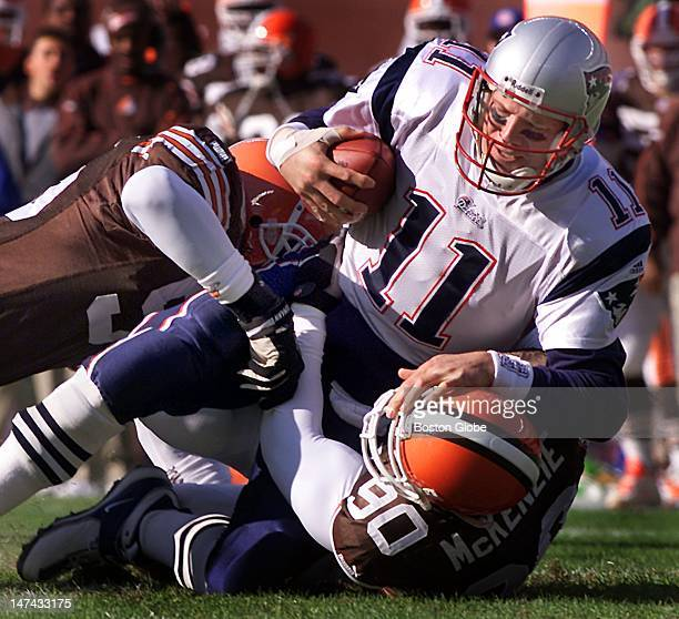 Patriots quarterback Drew Bledsoe is sacked by the Browns first half action