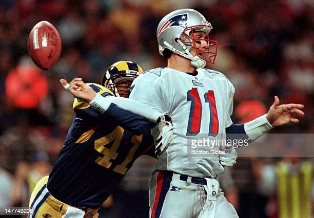 Patriots quarterback Drew Bledsoe loses the football as he is hit by the Rams' Todd Lyght The ball was recovered by St Louis deep in Patriots'...