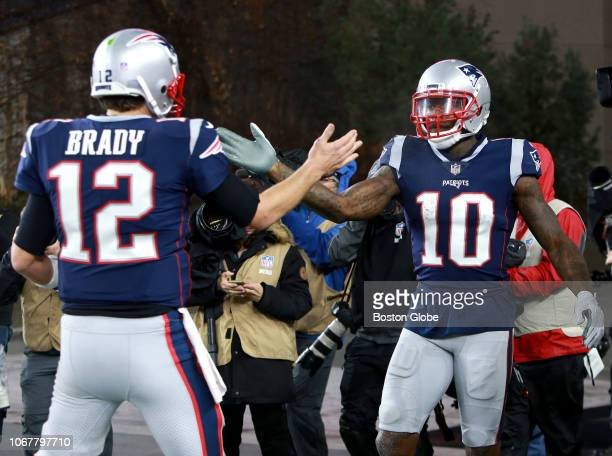 Patriots quarterback Tom Brady congratulates Josh Gordon after his touchdown in the third quarter The New England Patriots play against the Minnesota...