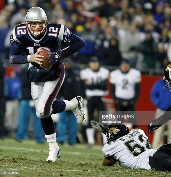 Patriots quarterback Tom Brady eludes the rush of the Jaguars' Daryl Smith as he rolls out and looks to pass The New England Patriots face the...