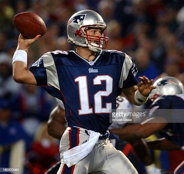Patriots quarterback Tom Brady fires the second of his four touchdown passes on the day, this one to Troy Brown.