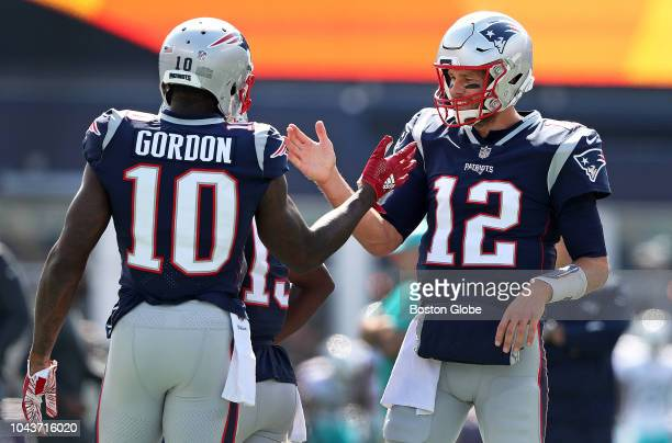 Patriots quarterback Tom Brady greets wide receiver Josh Gordon on the field during pre game warmups The New England Patriots hosted the Miami...