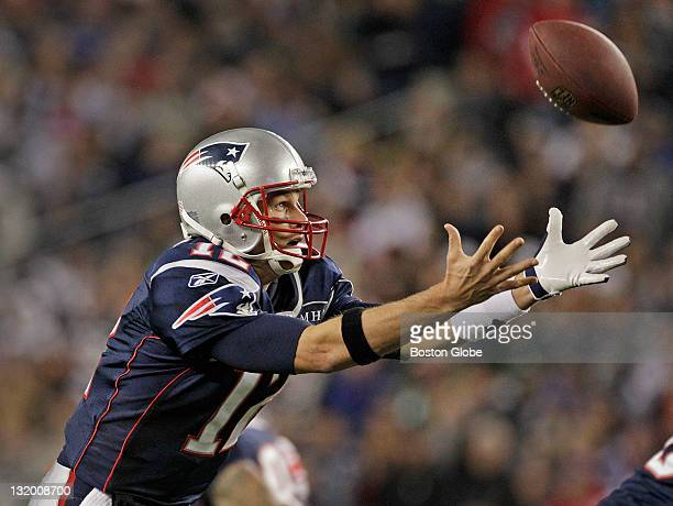 Patriots quarterback Tom Brady had a second quarter shotgun snap bounce off his hands and high into the air here he catches the fumble on the way...