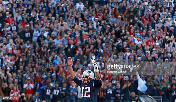 Patriots quarterback Tom Brady leads the cheers after running back LeGarrette Blount not pictured scored a second quarter touchdown The New England...