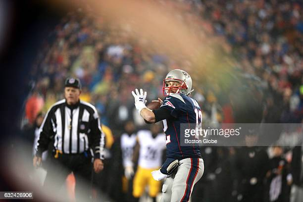 Patriots quarterback Tom Brady looks to pass the ball to teammate Chris Hogan in the first quarter Brady threw a successful touchdown pass to Hogan...