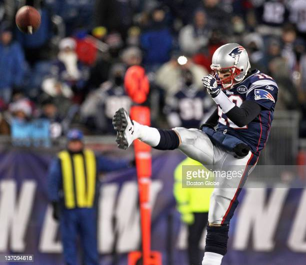 Patriots quarterback Tom Brady punts the ball in the fourth quarter The New England Patriots hosted the Denver Broncos in an NFL AFC Divisional...