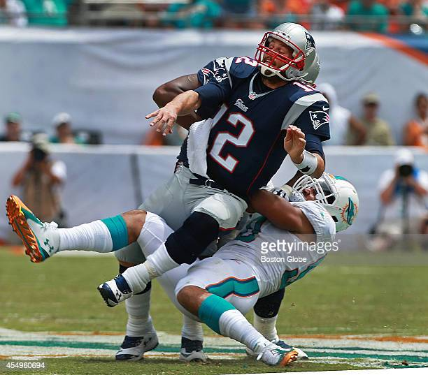 Patriots quarterback Tom Brady was feeling the heat from the Dolphins defense all day, including this takedown as he threw an incompletion in the...