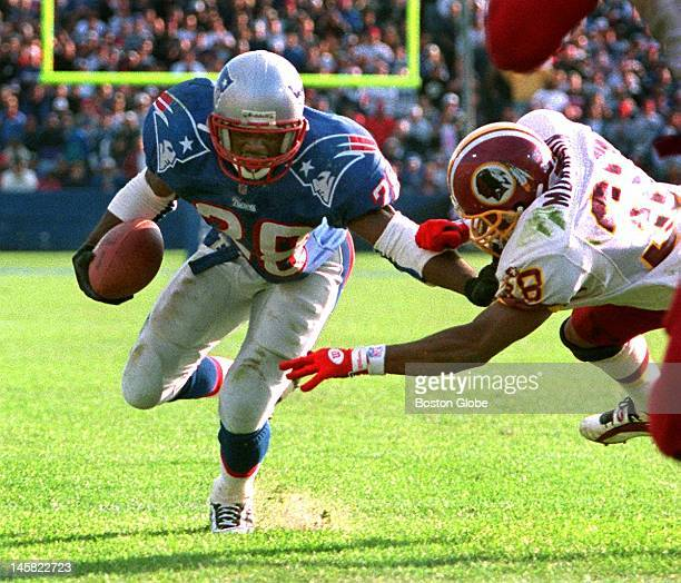 Patriots RB Curtis Martin is about to be stopped by Washington Redskins Darryl Morrison as he tries unsuccessfully to convert a twopoint conversion...