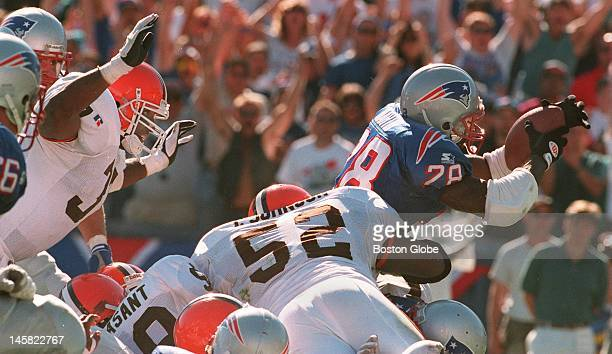 Patriots' rookie Curtis Martin makes his first NFL touchdown a big one as he just breaks the plane of the endzone scoring the winning TD for the...