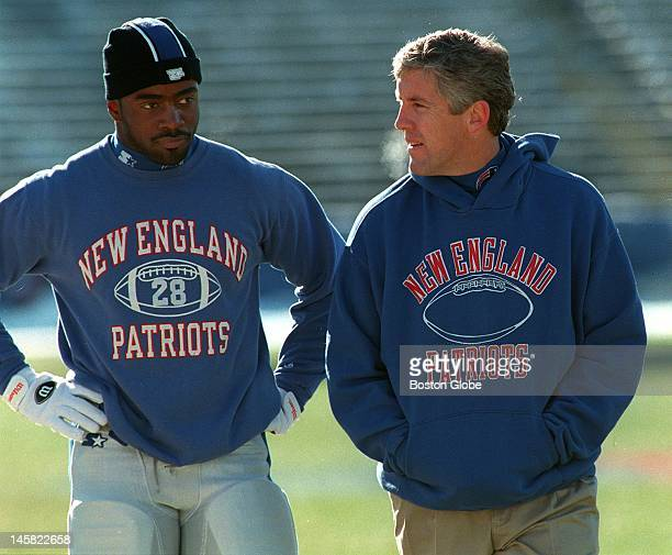 Patriots running back Curtis Martin and Head Coach Pete Carroll walk off the field at Foxboro Stadium a couple of hours before the start of the New...