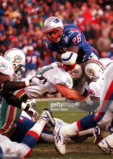 Patriots running back Curtis Martin dives over the Miami defensive line for his first touchdown of the game
