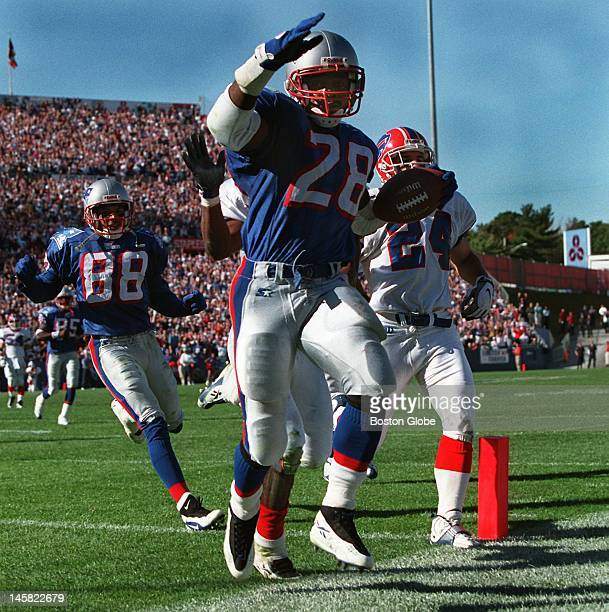 Patriots running back Curtis Martin tiptoes into the end zone with a touchdown ahead of Bills Kurt Schulz and teammate Terry Glen