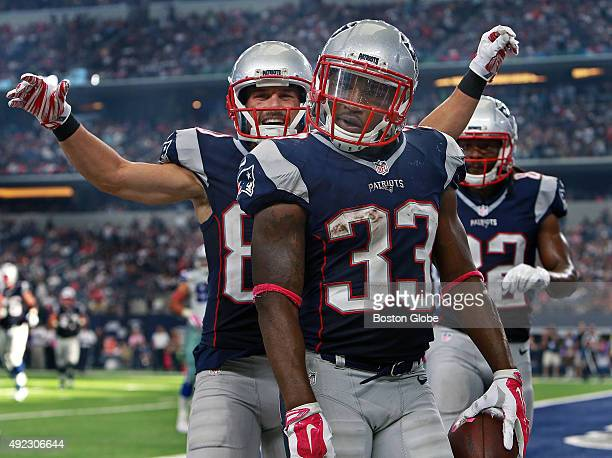 Patriots running back Dion Lewis celebrates with teammate Danny Amendola after he scored a third quarter touchdown after catching a pass from Tom...