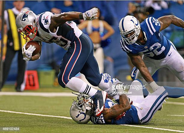 Patriots running back Jonas Gray runs over Colts defender Greg Toler as he bulls his way for some of the 199 yards he had rushing in the game The New...