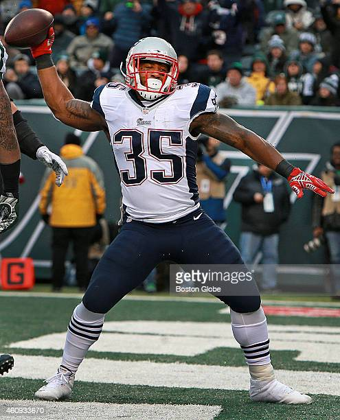 Patriots running back Jonas Gray spikes the ball after he scored a touchdown on a oneyard run in the fourth quarter with what would be the game...