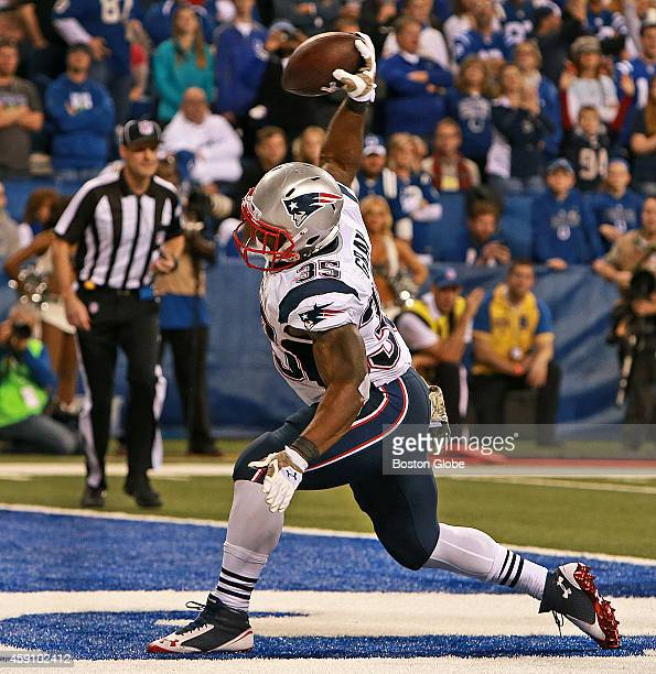 Patriots running back Jonas Gray spikes the ball after he scored the first of his four touchdowns in the game The New England Patriots took on the...