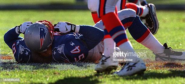Patriots Tedy Bruschi is prone after dropping the ill fated pass attempt from punter Tom Tupa first quarter