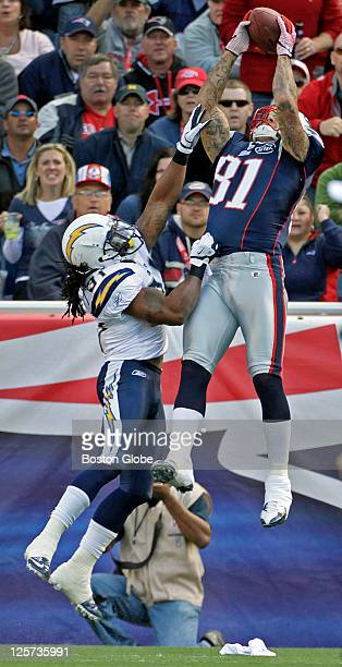Patriots tight end Aaron Hernandez out leaps Chargers defender Bob Sanders as he hauls in a 14 yard touchdown pass from Tom Brady in the first...
