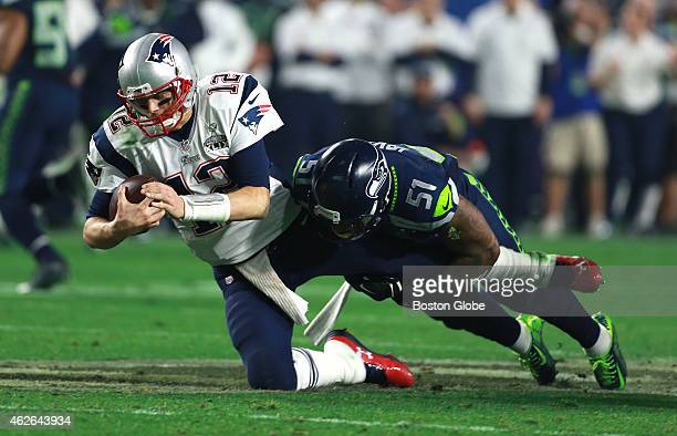 Patriots Tom Brady gets sacked by Seahawks Bruce Irvin in the fourth quarter. The New England Patriots plays against the Seattle Seahawks Sunday,...