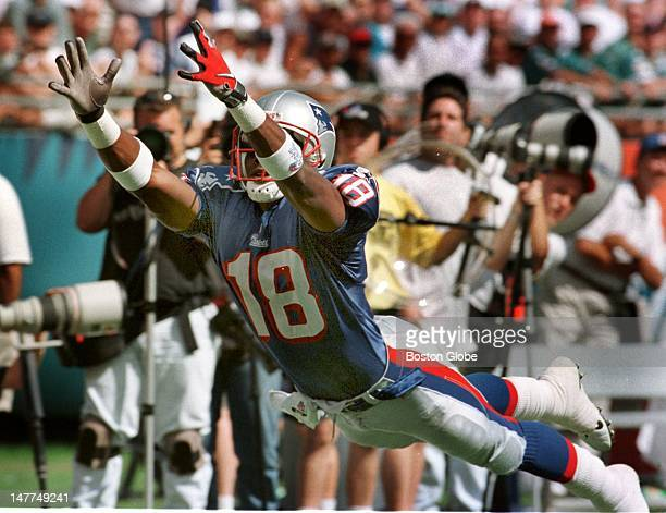 Patriots wide receiver Anthony Ladd stretches as far as he could but was unable to catch Drew Bledsoe's pass the pass was way out of his reach