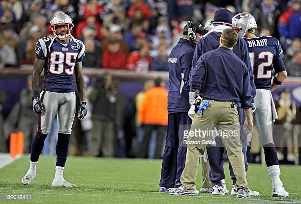 Patriots wide receiver Chad Ochocinco left is out of the conversation as quarterback Tom Brady right and the New England brain trust talk strategy on...