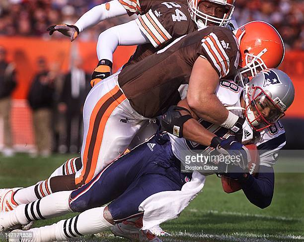 Patriots wide receiver Terry Glenn has the pass but the Browns defense has him