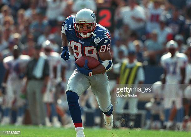 Patriots wide receiver Terry Glenn has the whole area to himself as he hauls in a Drew Bledsoe pass and heads upfield on his way to the end zone with...