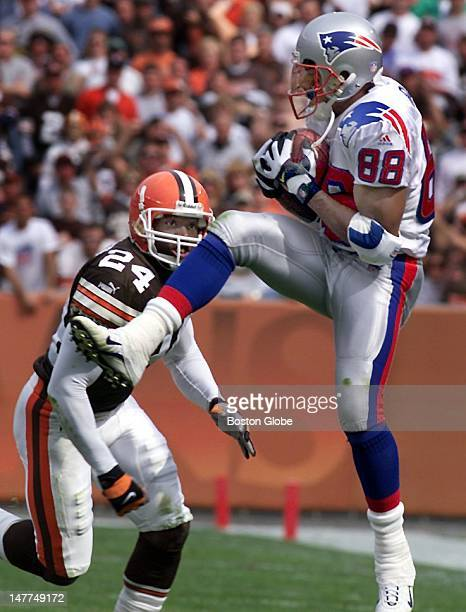 Patriots wide receiver Terry Glenn hauls in a Drew Bledsoe pass as Cleveland's DB Corey Fuller is too late on the coverage