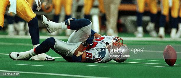 Patriots wide receiver Terry Glenn holds his right leg as he was injured yet again this time while attempting to make a catch during the Patriots vs...