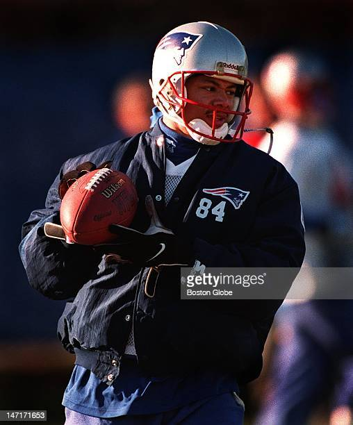 Patriots wide receiver Terry Glenn was bundled up in Shawn Jefferson's coat at practice today