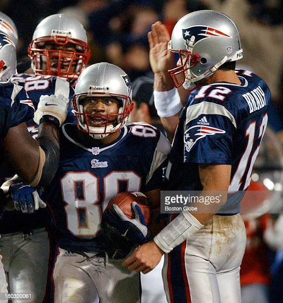 Patriots wide receiver Troy Brown gets a hand from quarterback Tom Brady following his touchdown catch