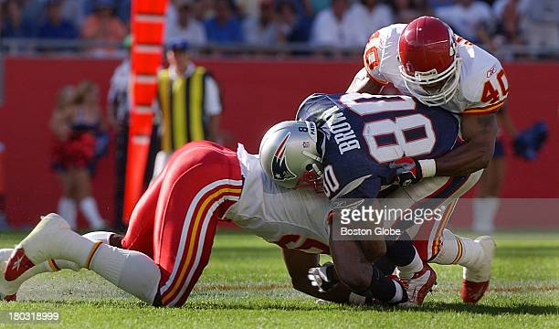 Patriots wide receiver Troy Brown is sandwiched between Chiefs defenders Gary Stills and Corey Harris on the play on which he was injured late in the...