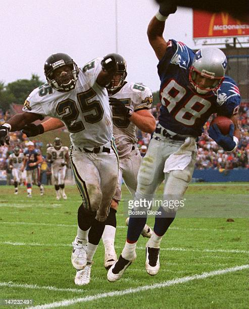 Patriots WR Terry Glenn is shove out of bounds by Jaguars Mickey Washington and Tom McManus following a clutch catch on the OT drive that set up the...