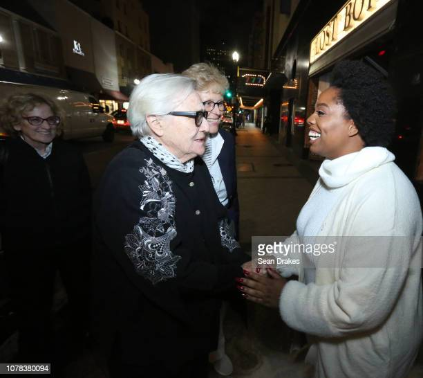 Patrisse Cullors greets Los Angeles residents Paula Lombard Susan Ronnie and Kirsten Grimstad after performing 'Untitled It's Dangerous Times We Have...