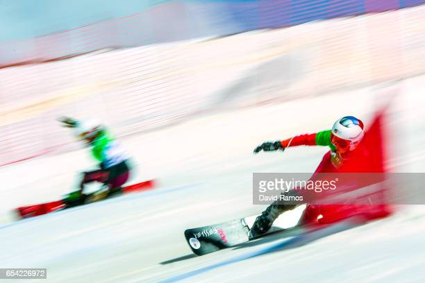 Patrizia Kummer of Switzerland and Julia Dujmovits of Austria compete in the quarterfinal round of the Women's Parallel Giant Slalom on day 9 of the...