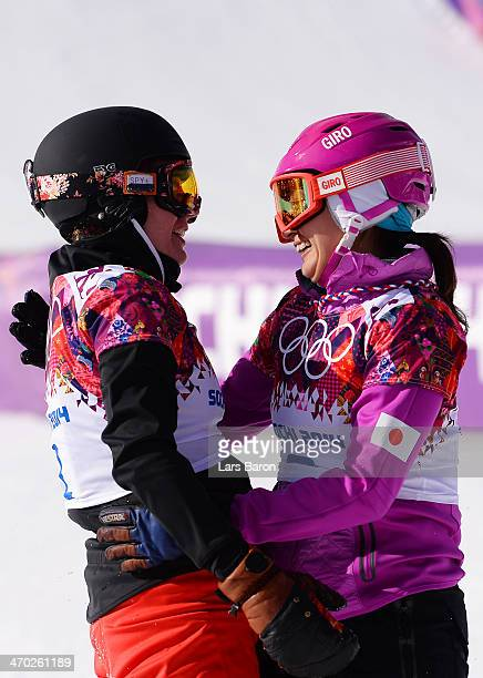 Patrizia Kummer of Switzerland and Tomoka Takeuchi of Japan celebrate winning the gold and silver medals in the Snowboard Ladies' Parallel Giant...
